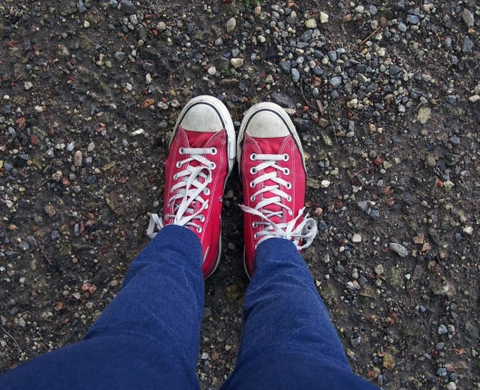 Red sneakers on gravel
