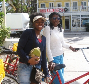 Phoebe & mother on red cruiser bikes, Key West, FL